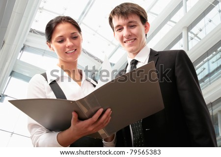 Business partners are working together in the lobby of a modern office center - stock photo