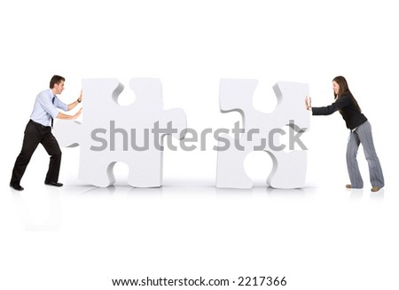 business partners building a puzzle over white - stock photo