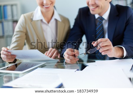 Business partners discussing document at meeting - stock photo