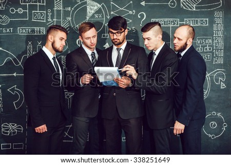 Business partners discussing documents - stock photo
