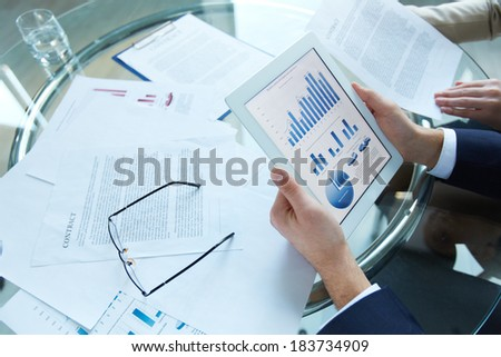 Business partners discussing documents at meeting - stock photo