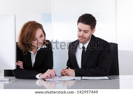 Business partners discussing together in office at meeting