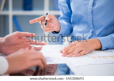 Business partners explaining the strategy at the office - stock photo