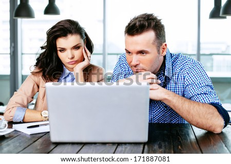 Business partners fosusing on online options - stock photo