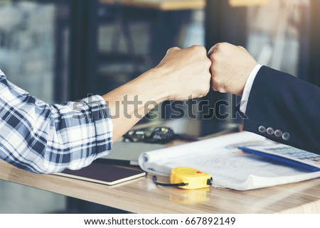 Business Partners Giving Fist Bump after complete a deal. Successful Teamwork Hands Gesture. Partnership Business Concept.