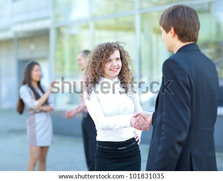 Business partners handshaking after negotiating and signing contract - stock photo