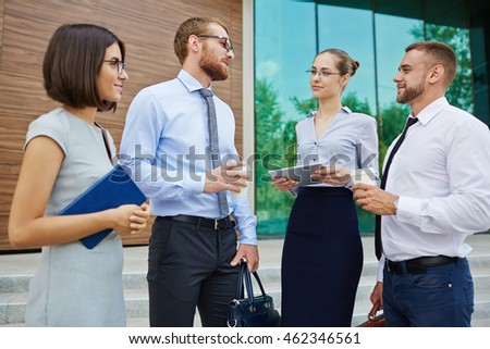 Business partners having a meeting outdoors in the city
