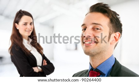 Business partners in an office welcoming you - stock photo