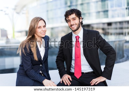 Business partners in an urban setting - stock photo