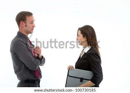 Business partners in conversation Stylish business partners standing sideways in deep conversation while sharing information and ideas - stock photo