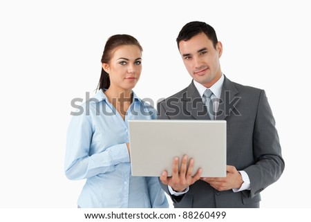 Business partners looking at laptop against a white background