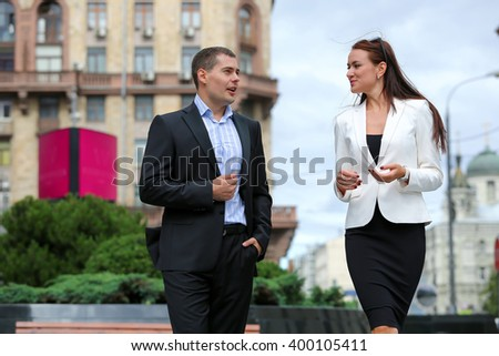 Business partners meet on the street
