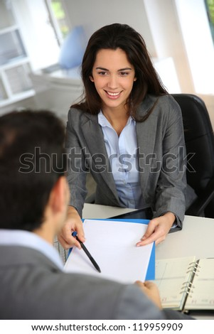 Business partners meeting for contract signature - stock photo