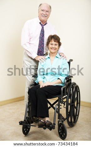 Business partners or married couple - the woman is in a wheelchair.