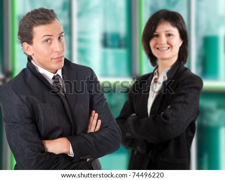 Business partners over a blurred glass building background