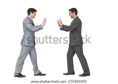 Business partners pushing copy space on white background