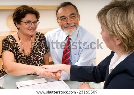 business partners shaking hands  making a agreement - stock photo