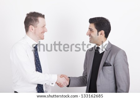 business partners shaking hands. studio shot on a white Background. - stock photo