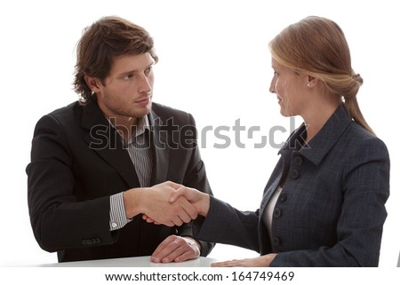 Business partners shaking their hands at the end of the meeting - stock photo