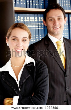 business partners smiling in an office - stock photo