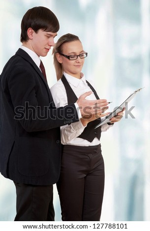 Business partners standing and looking at document - stock photo