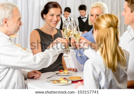 Business partners toast champagne company event celebration success - stock photo