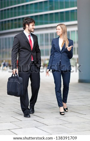 Business partners walking outdoor in the city - stock photo