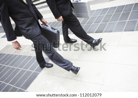 Business partners walking together - stock photo