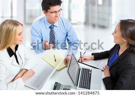 Business partners working at a computers in an office