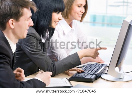 Business partners working at a computers in the office - stock photo