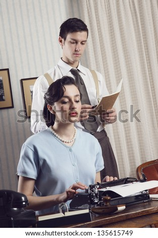 Business partners working in an office, vintage style