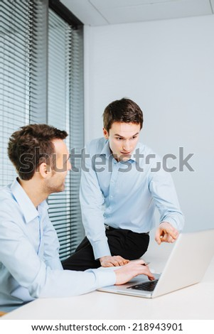 Business partners working in office - stock photo
