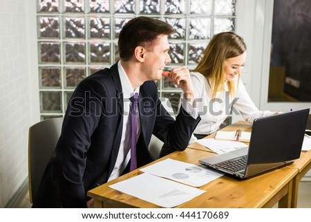 business partners working on a laptop - stock photo