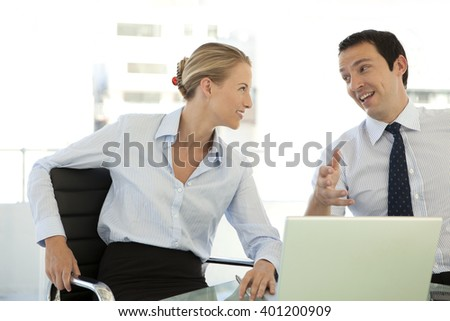 Business partners working on laptop
