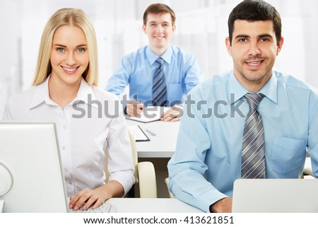 Business partners working on new project at modern office - stock photo
