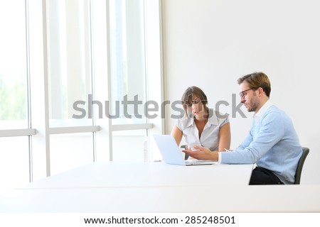 Business partners working on project, copyspace - stock photo