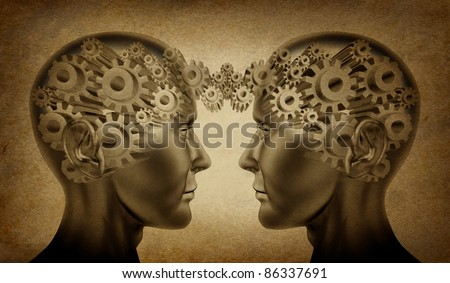 Business partnership and teamwork symbol represented by two human heads with gears connected together as a symbol of network referrals and relationships on an old grunge parchment background. - stock photo