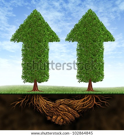 Business partnership growth as an icon of financial cooperation between two partners as trees in the shape of arrows growing and plant roots shaped as shaking hands resulting in success. - stock photo