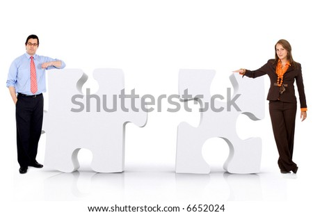 business partnership of a couple of businesspeople leaning on puzzle pieces isolated over a white background - stock photo