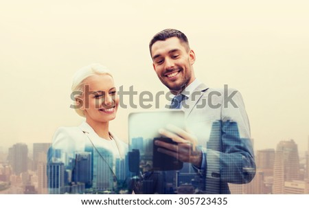 business, partnership, technology and people concept - smiling businessman and businesswoman with tablet pc computer over city background - stock photo