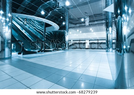 business passage and escalators in airport