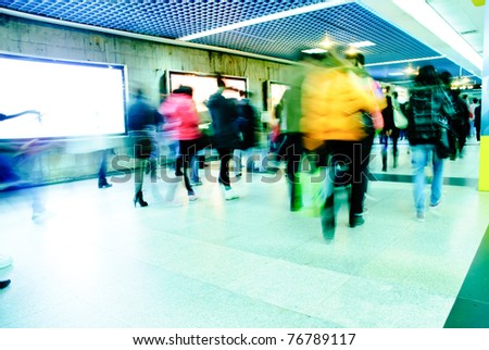 Business passenger walk at subway station at intentional motion blurred