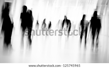 Business passenger walk at subway station black and white - stock photo