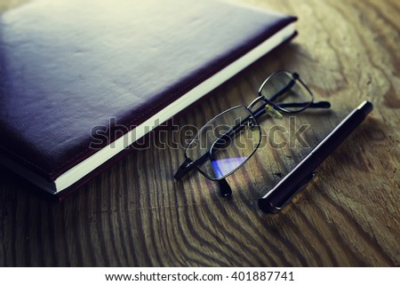 business pen glasses notebook - stock photo