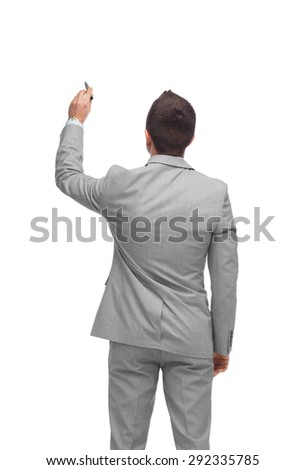 business, people, advertisement , information and office concept - businessman writing or drawing something imaginary from back - stock photo