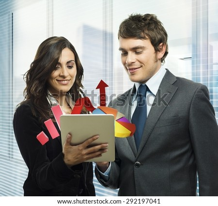 Business people analyze in a tablet graphics - stock photo