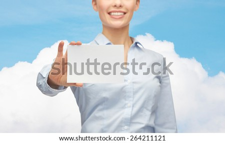 business, people and advertisement concept - close up of smiling businesswoman showing white blank card over blue sky and cloud background - stock photo