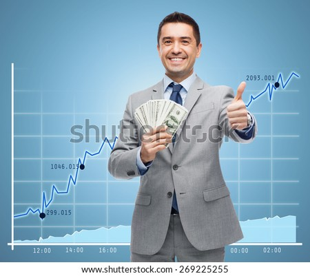 business, people and finances concept - smiling businessman with european money showing thumbs up over growing chart and blue background - stock photo