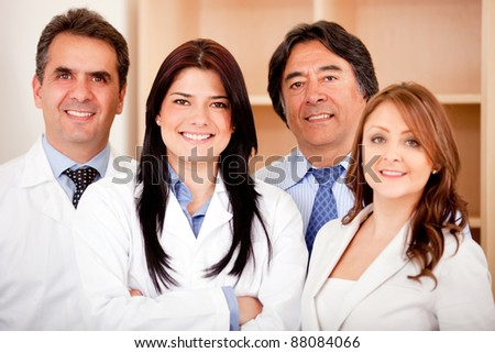 Business people and medical staff at the hospital smiling - stock photo