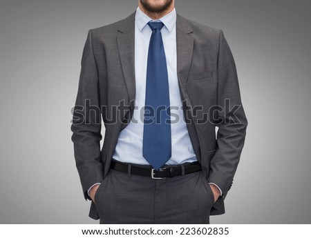 business, people and office concept - close up of businessman over gray background - stock photo